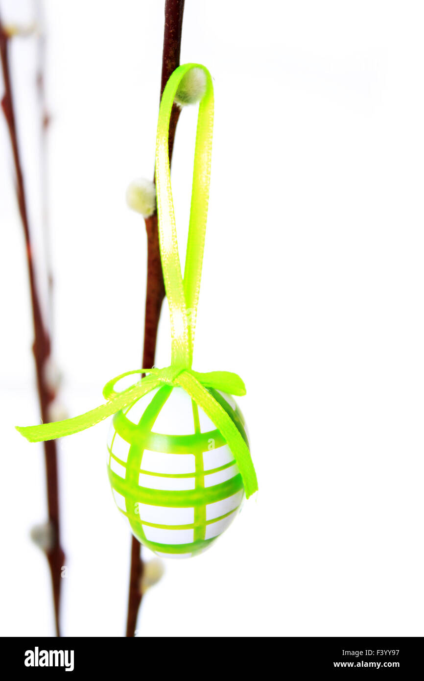 Easter egg individually hanging on a branch - Stock Image