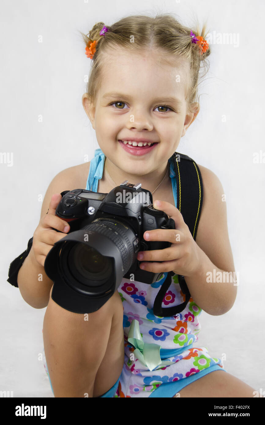 merry girl keeps SLR camera - Stock Image