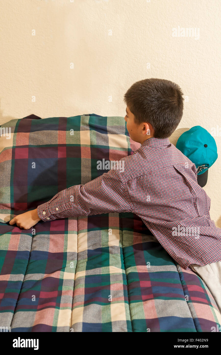 California child children making bed helping responsible  racially diverse multicultural  multi cultural interracialKorean/American - Stock Image