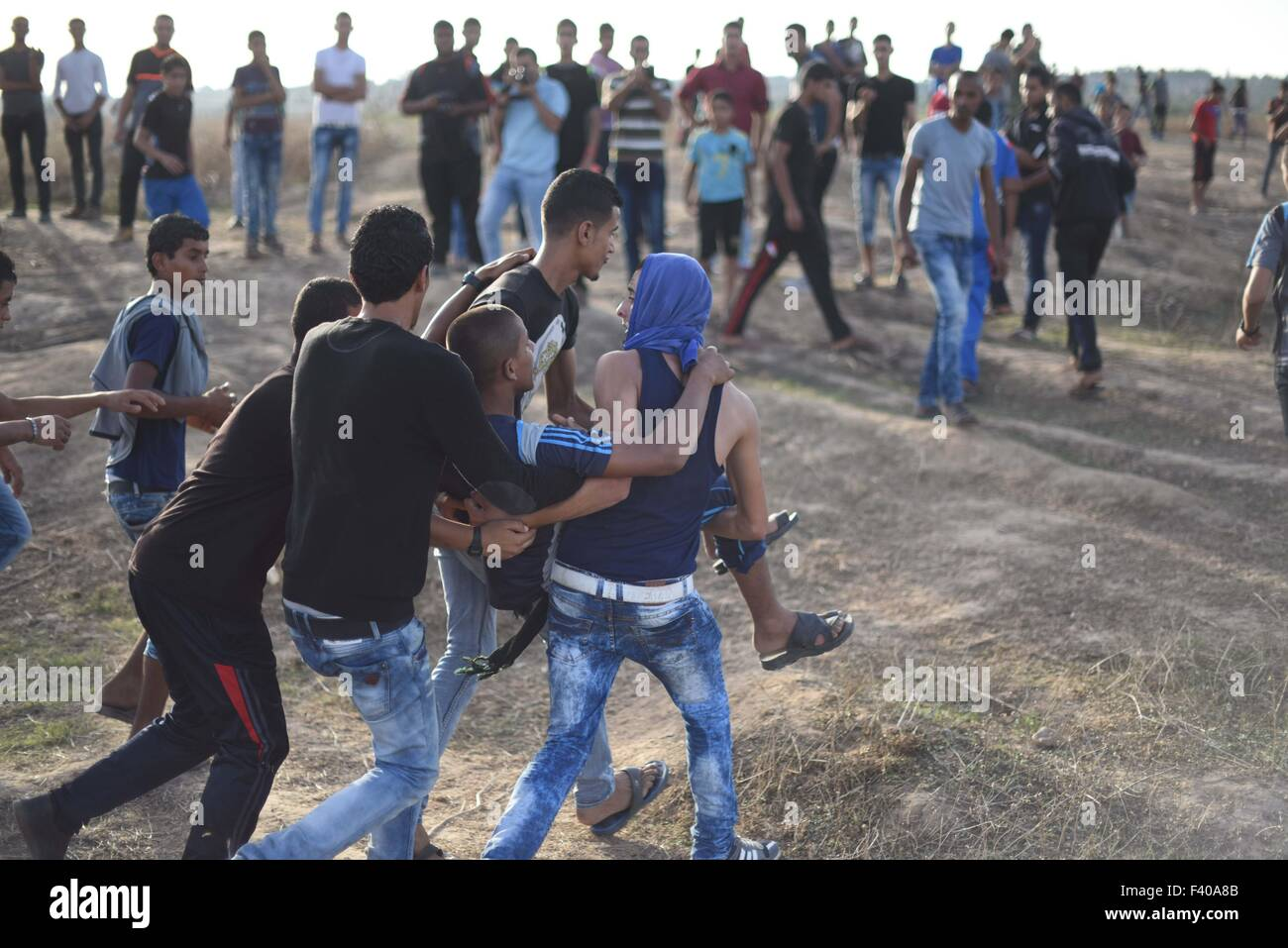 The Palestinian protesters evacuated after they was shot by Israeli troops near the border between Israel and Central - Stock Image