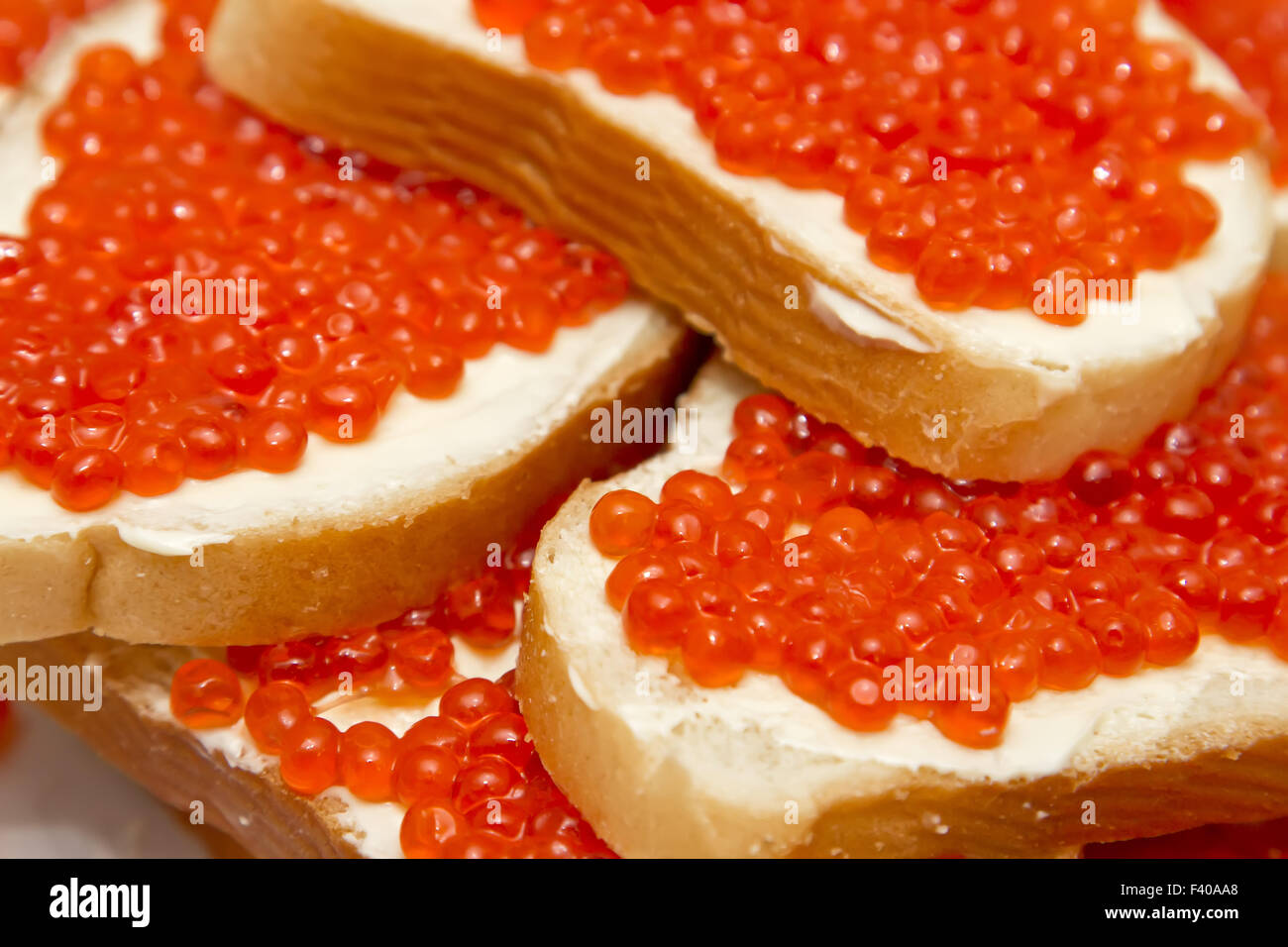 Sandwiches with red caviar - Stock Image