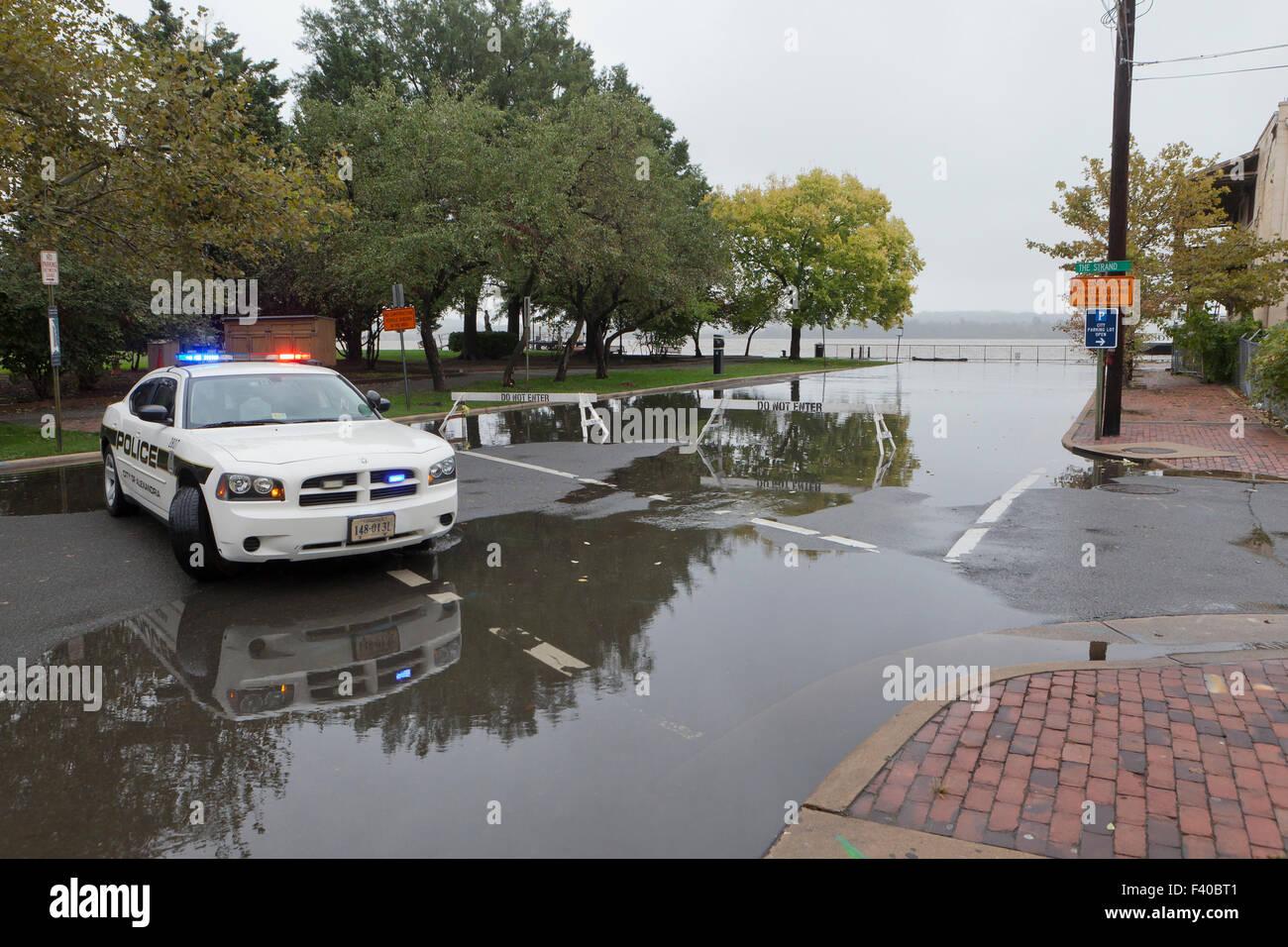 Police car blocking flooded road - Alexandria, Virginia USA Stock Photo