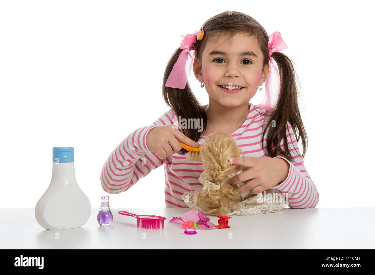 girl playing with doll - Stock Image