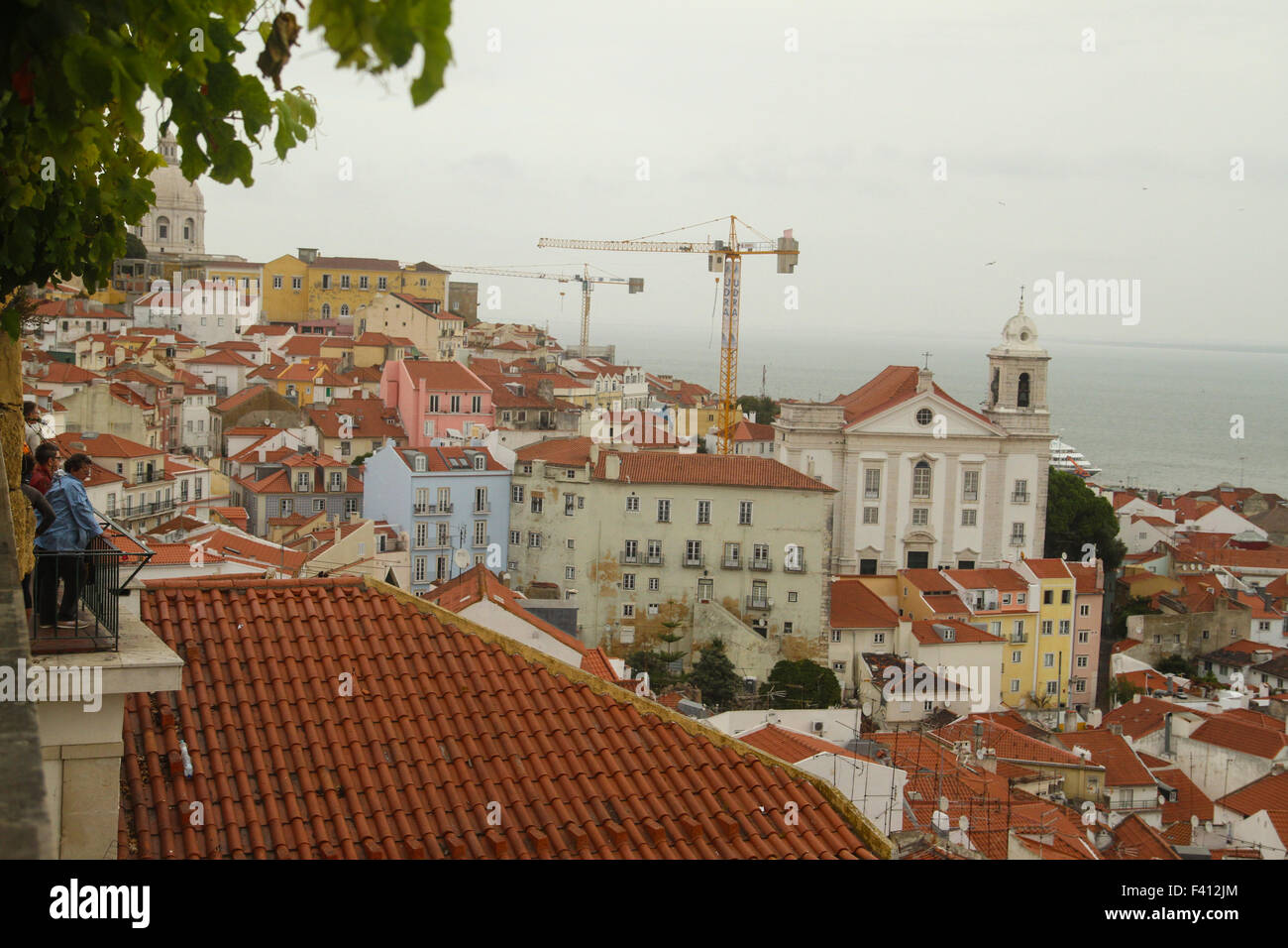​Lisbon, Portugal, 4 October, 2015. Tourists seen from a viewing platform in Alfama. Alfama is the oldest district - Stock Image