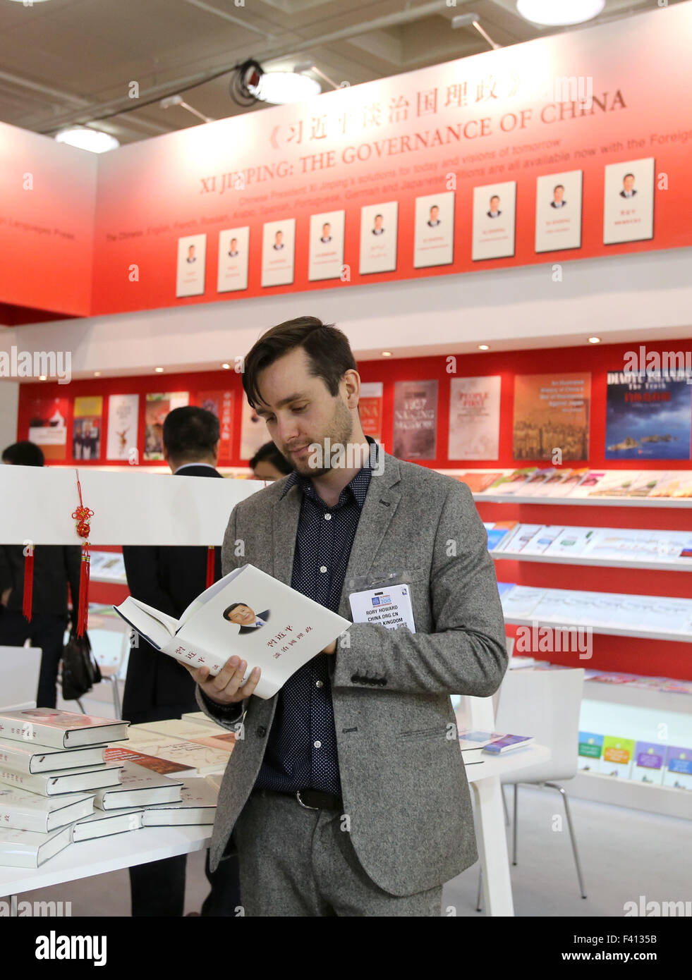 """London, UK. 14th Apr, 2015. File photo taken on April 14, 2015 shows a man reading the book """"Xi Jinping: the Governance Stock Photo"""