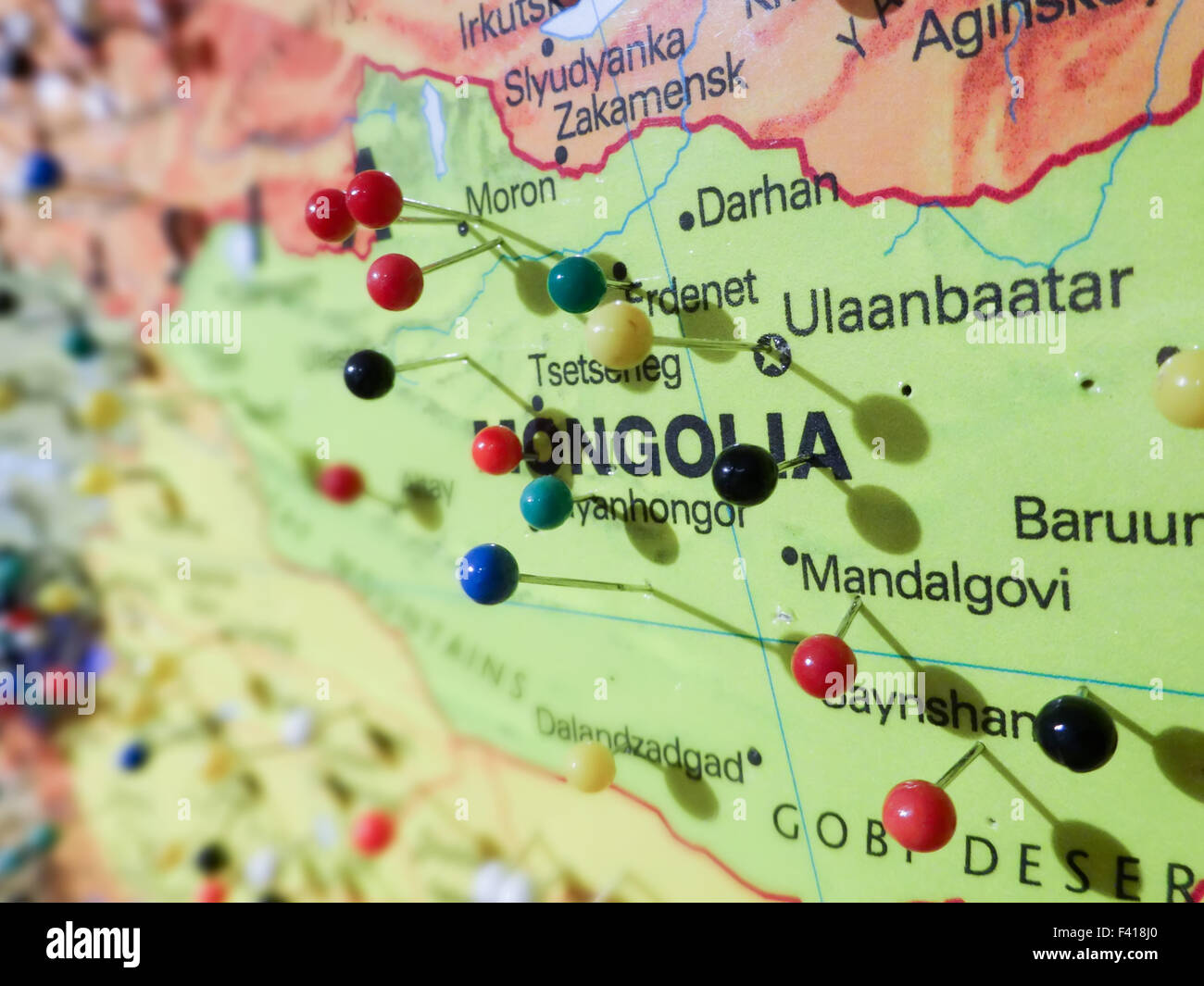 many pins over mongolia map - Stock Image