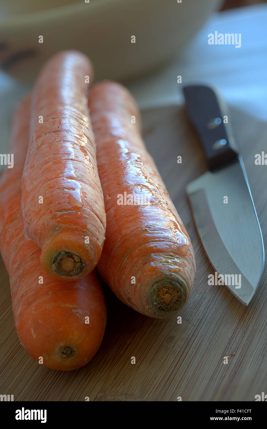 Carrots and Kitchen Knife - Stock Image