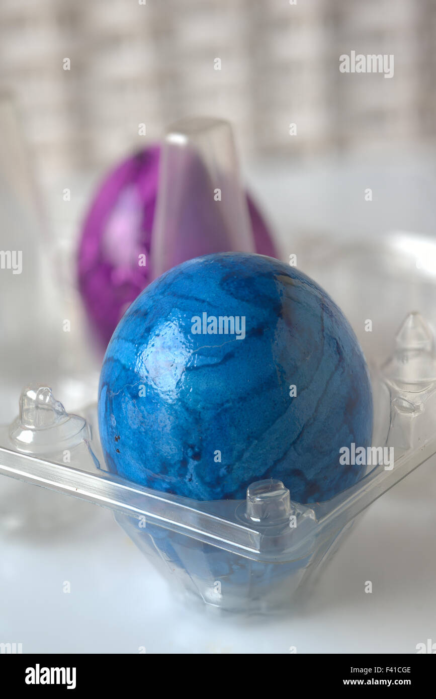 Two Easter Eggs in a Transparent Cradle Stock Photo
