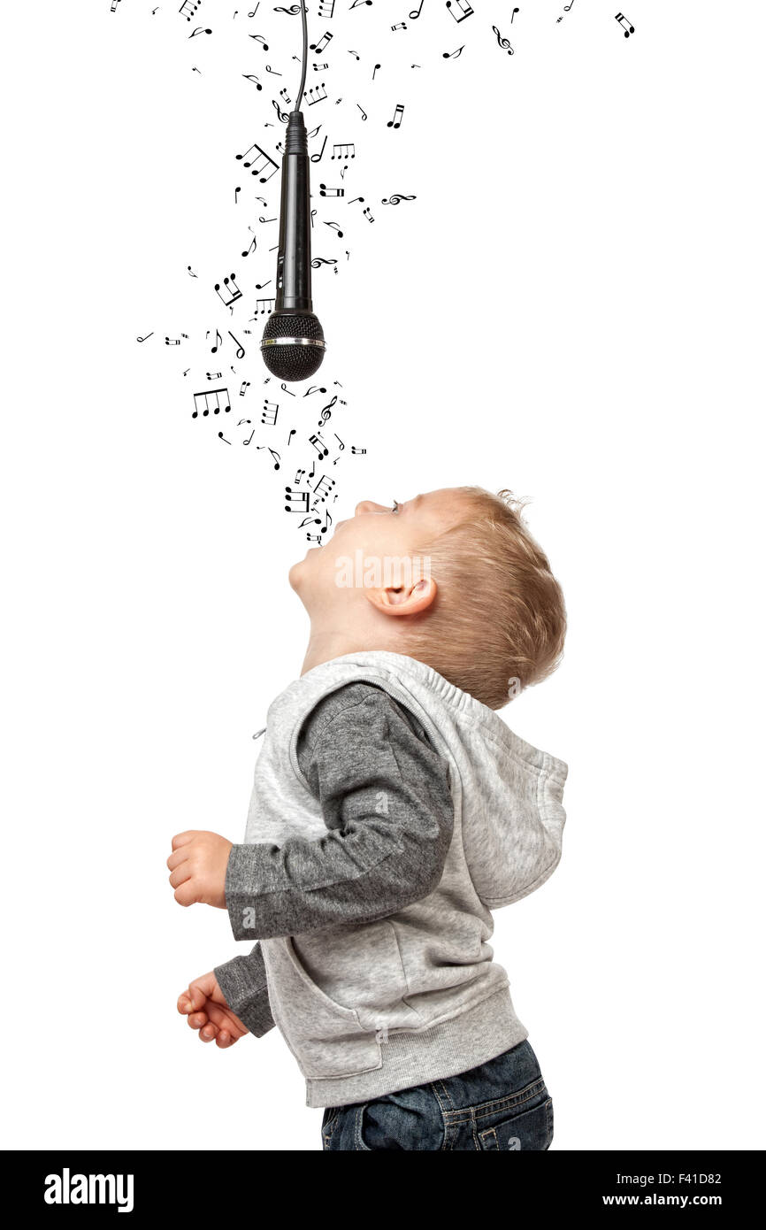 child sing and enjoy with microphone isolate don white background - Stock Image