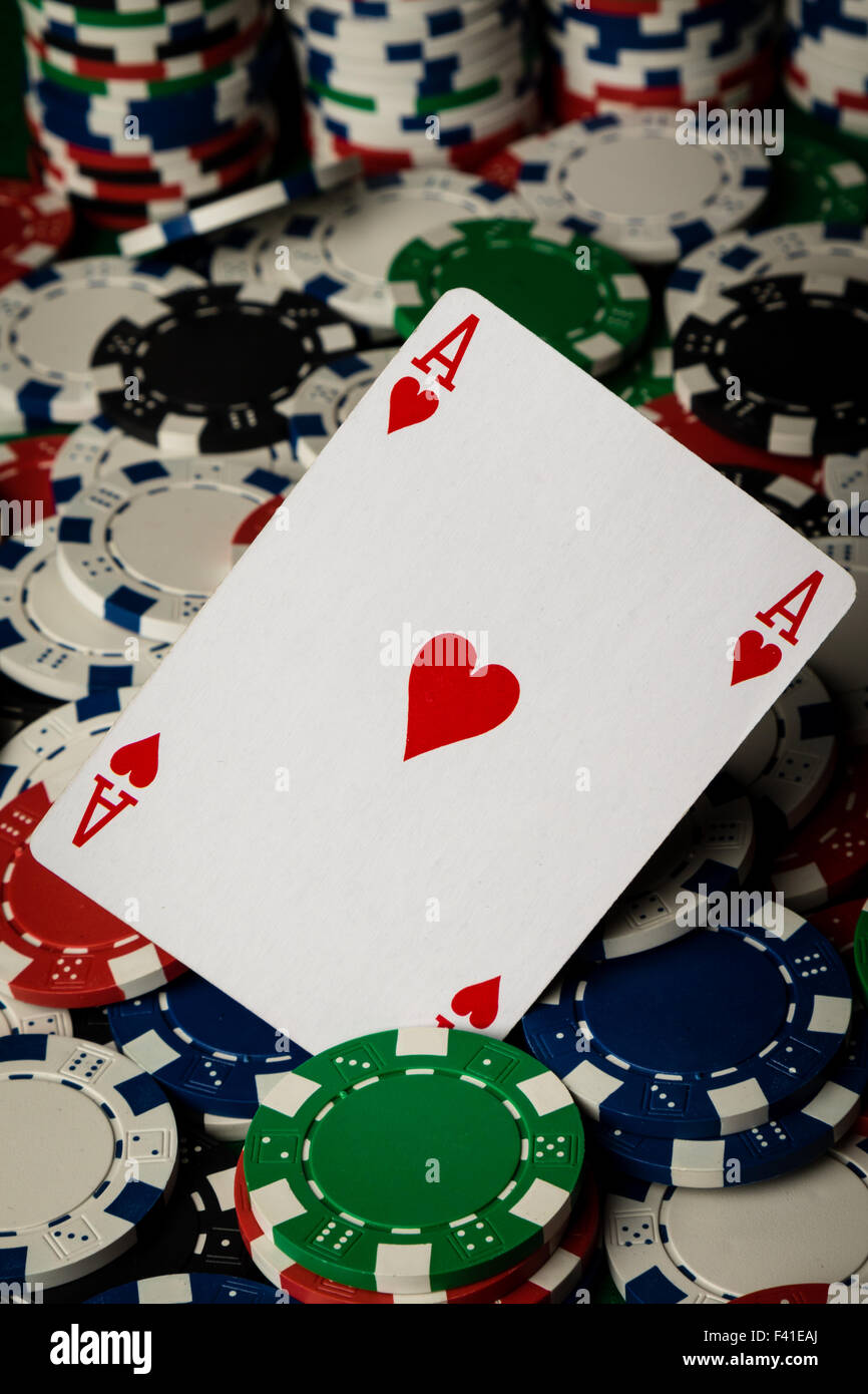 Ace of hearts and poker chips - Stock Image