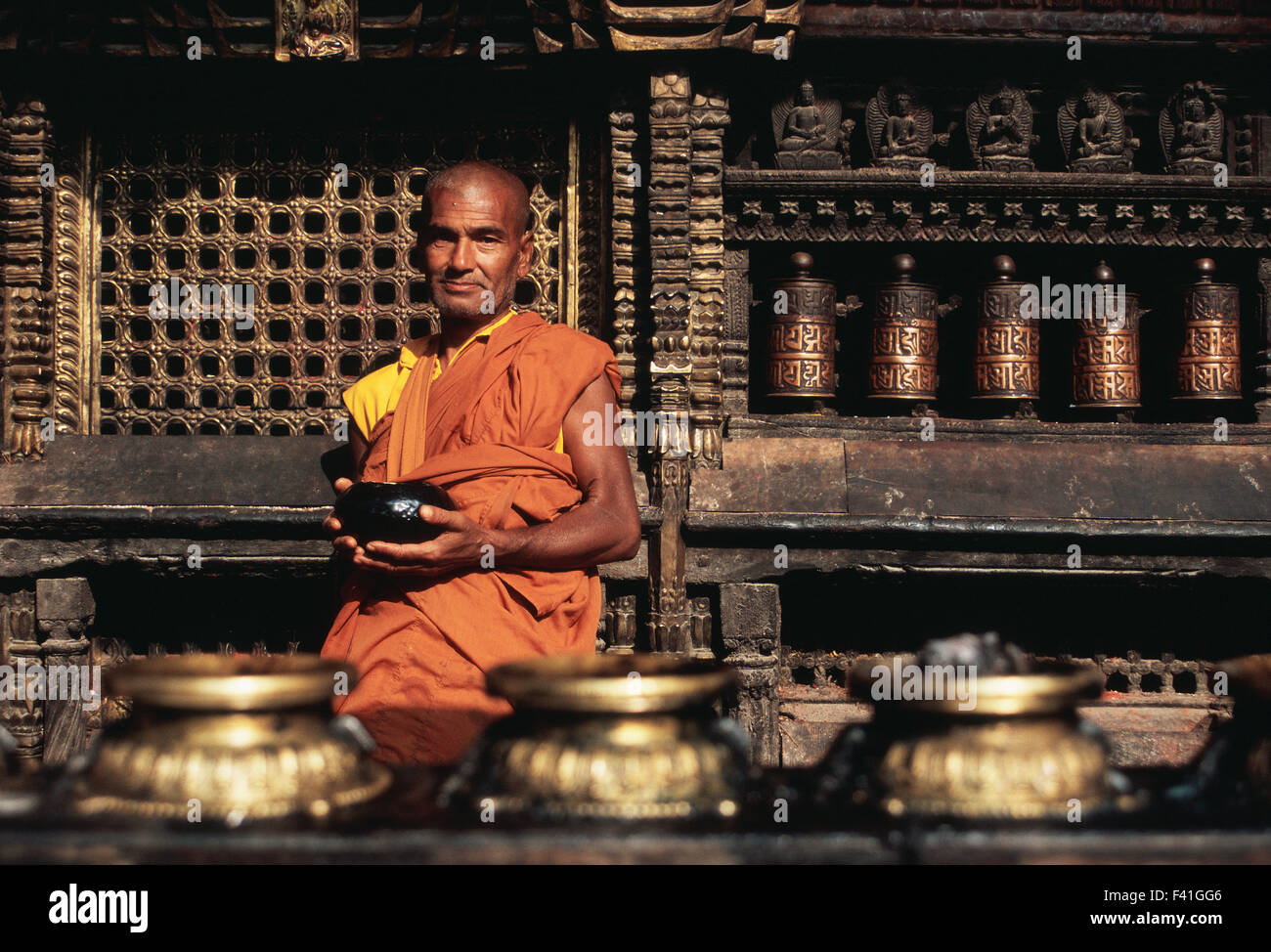 Theravada buddhist monk waiting for alms in the Harati temple ( Nepal) - Stock Image