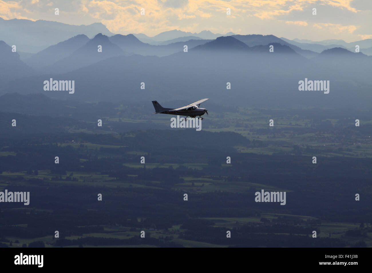 sports aeroplane in front of  the Alps - Stock Image