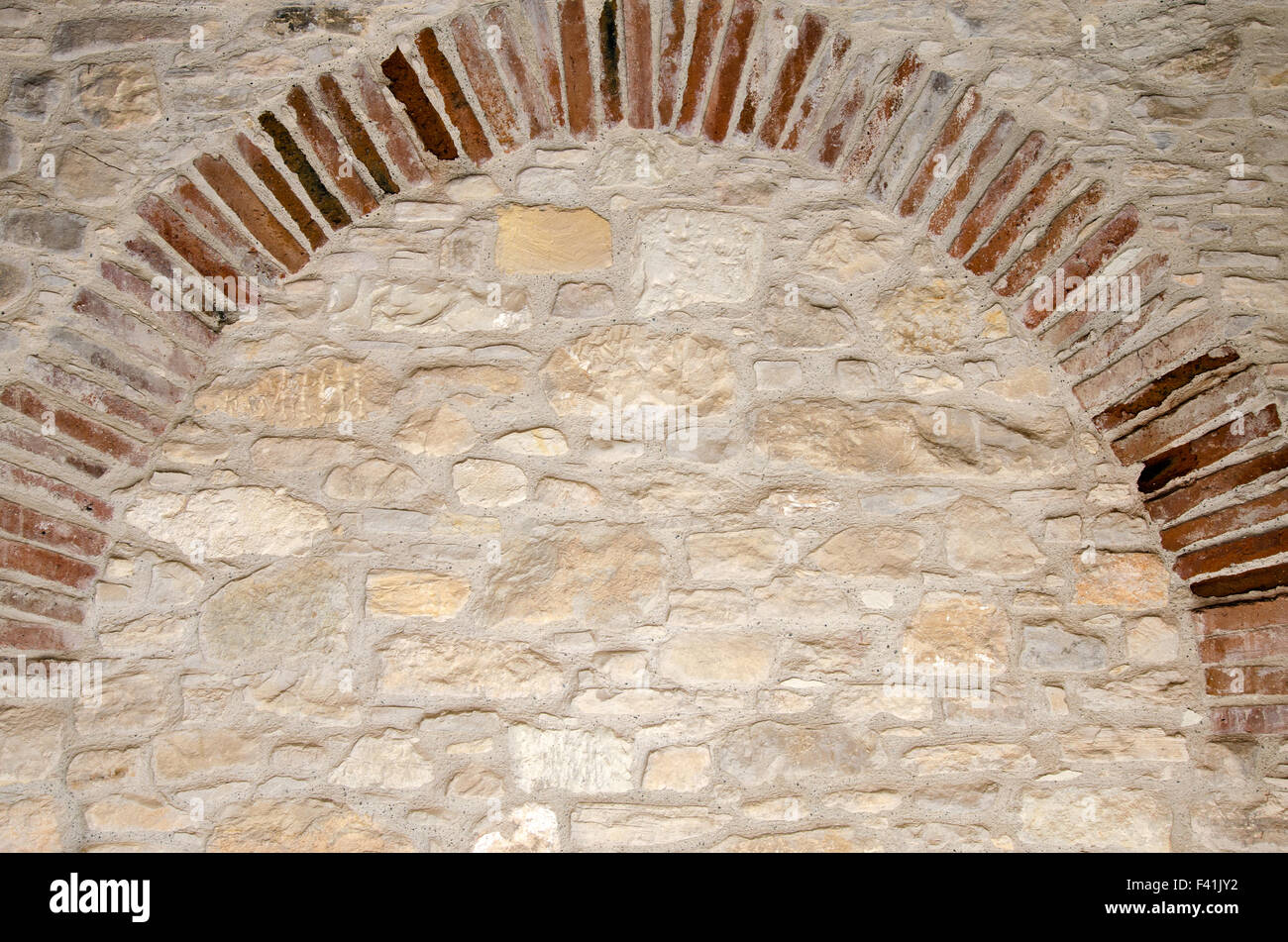 Old brick wall with arch imitation - Stock Image