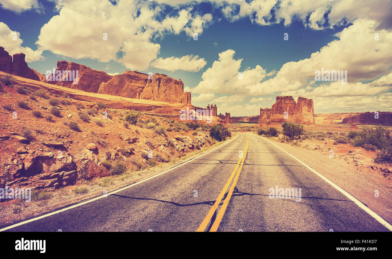 Vintage retro stylized scenic desert road, USA. - Stock Image