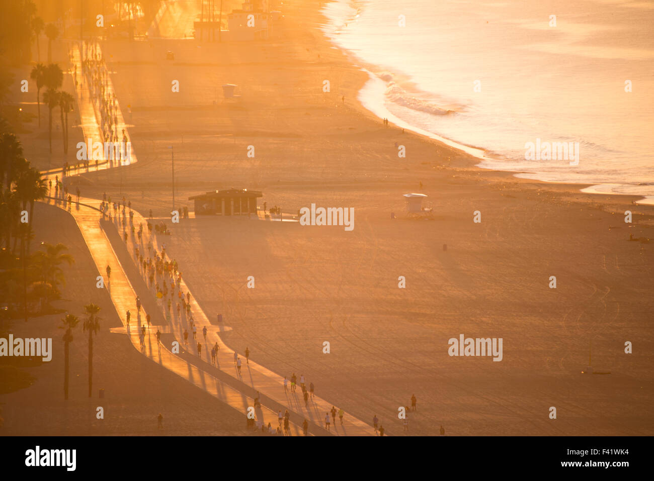 View from above of runners on the beach path at sunrise during the Long Beach Marathon Long Beach Southern California - Stock Image