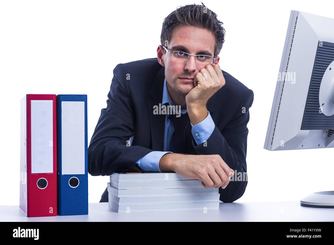 Businessman doubts his work - Stock Image