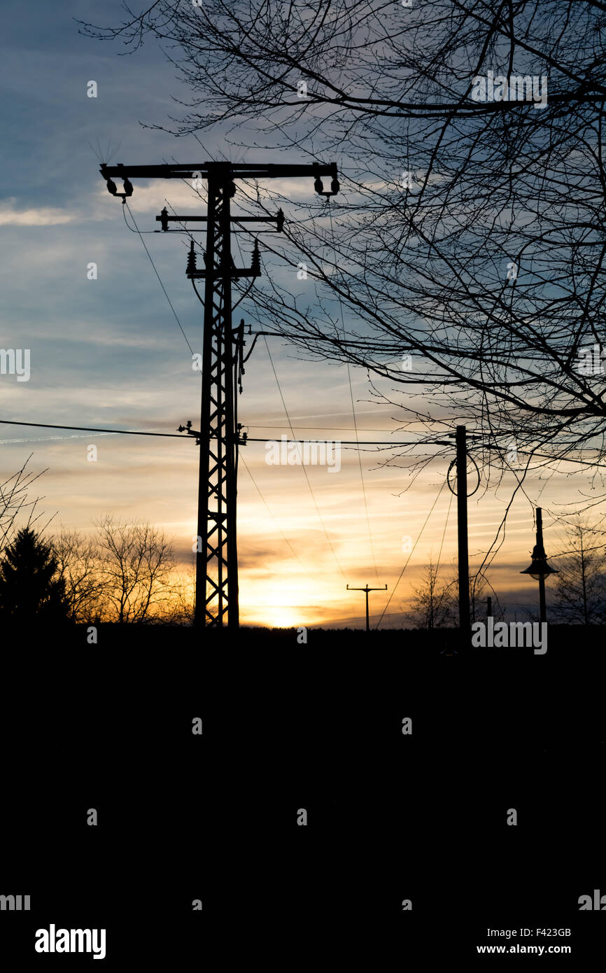 Power pole in sunset - Stock Image