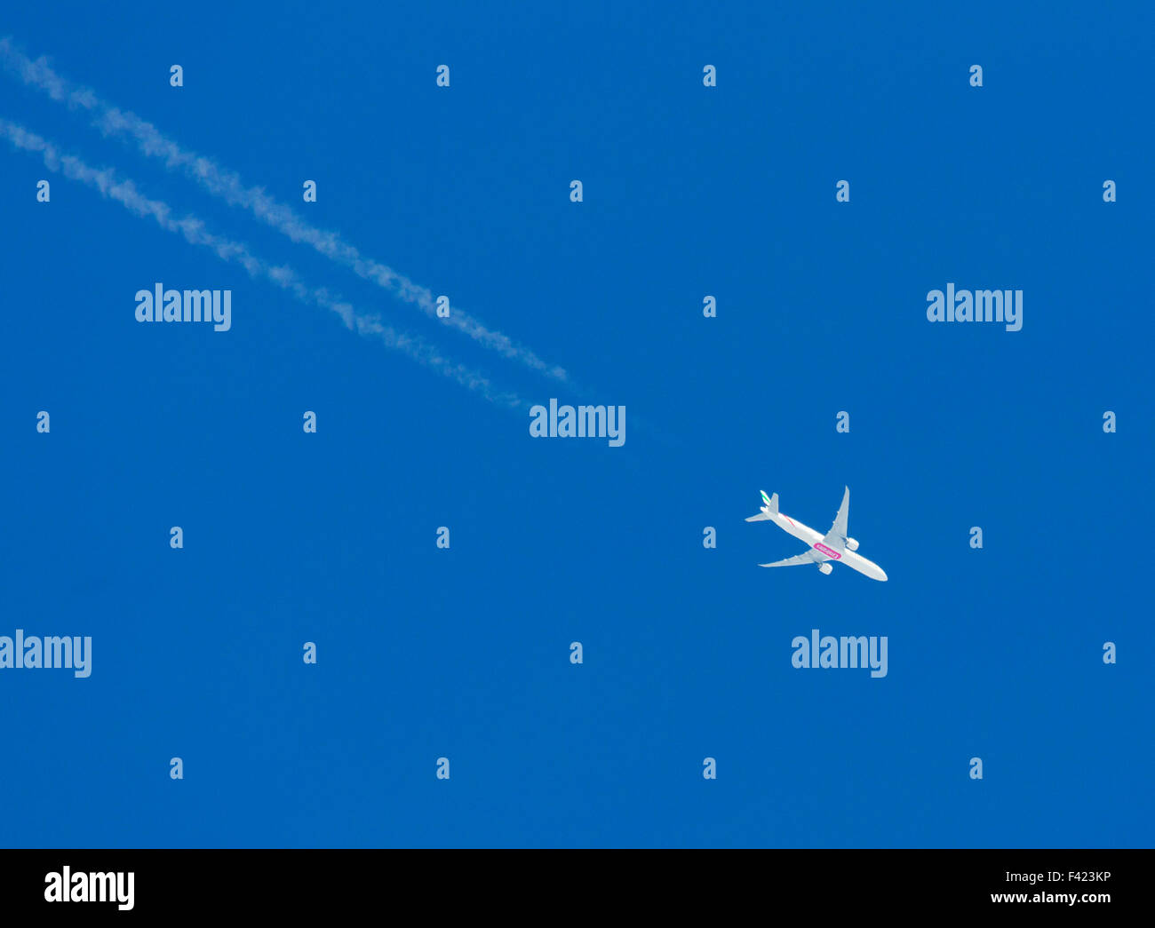 Emirates passenger aircraft flying over the UK - Stock Image