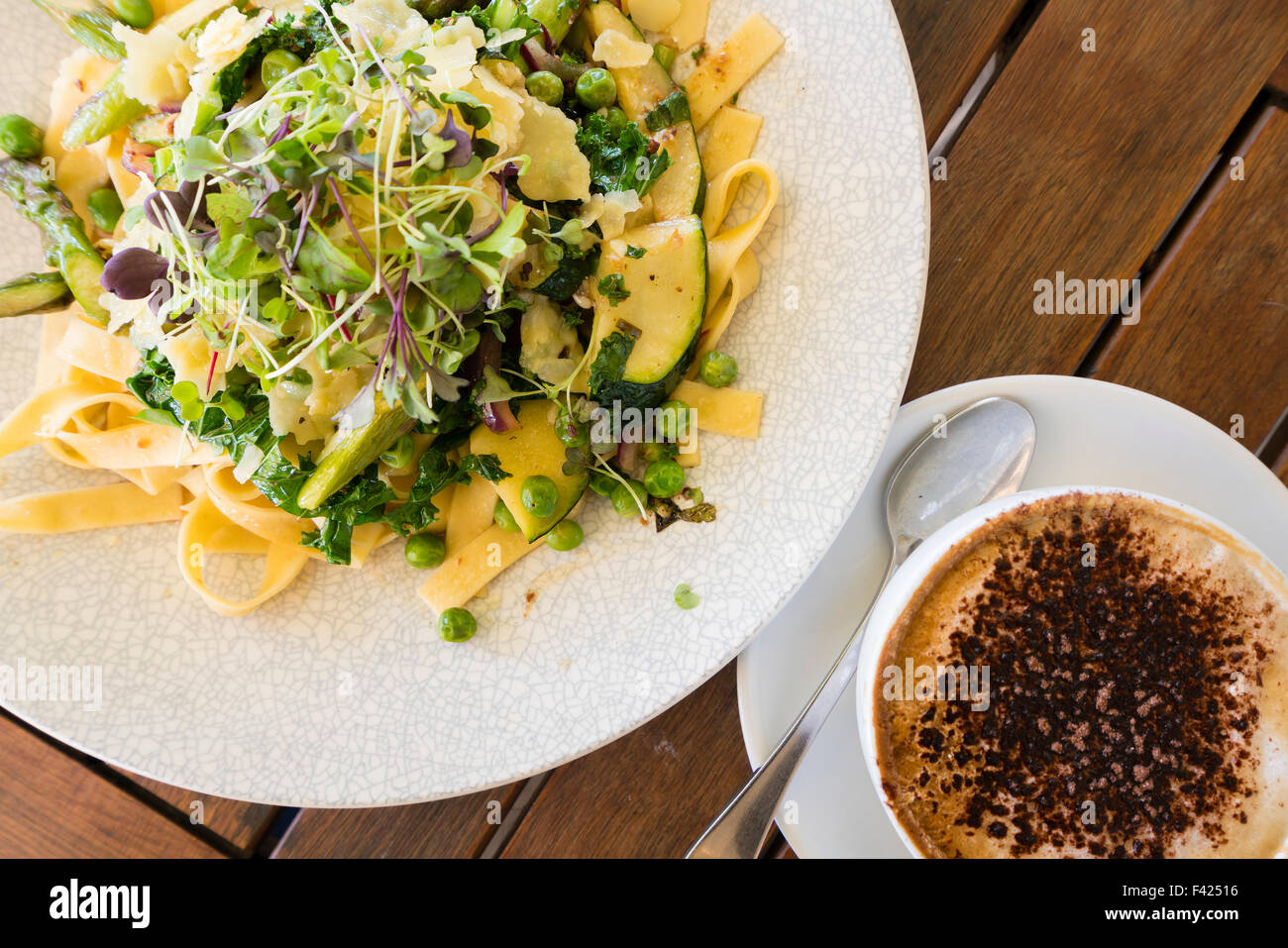 Top down view of pasta and coffee - Stock Image