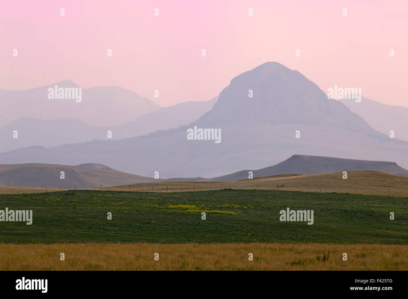 Sunset view of the Rocky Mountains off Hwy.287, south of Augustus, Montana, USA. - Stock Image