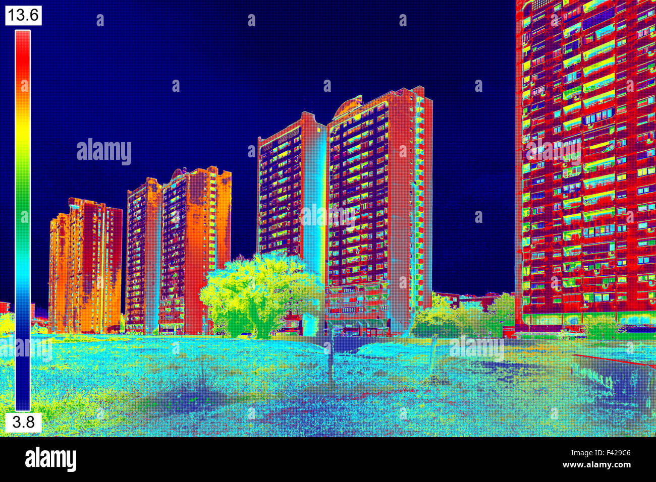Infrared thermovision image showing lack of thermal insulation on Residential building - Stock Image