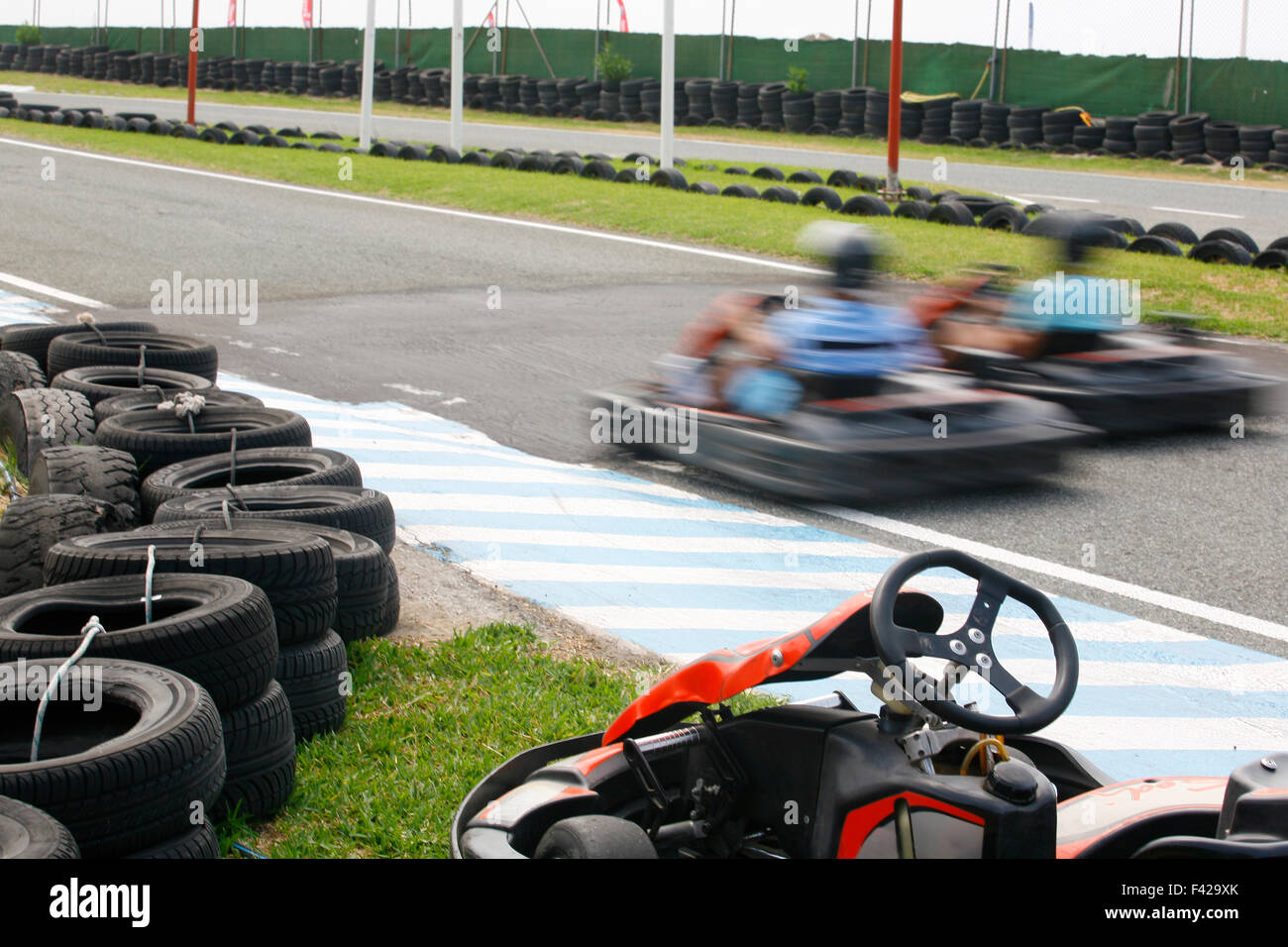 Unknown pilots having fun at karting track , Spain - Stock Image