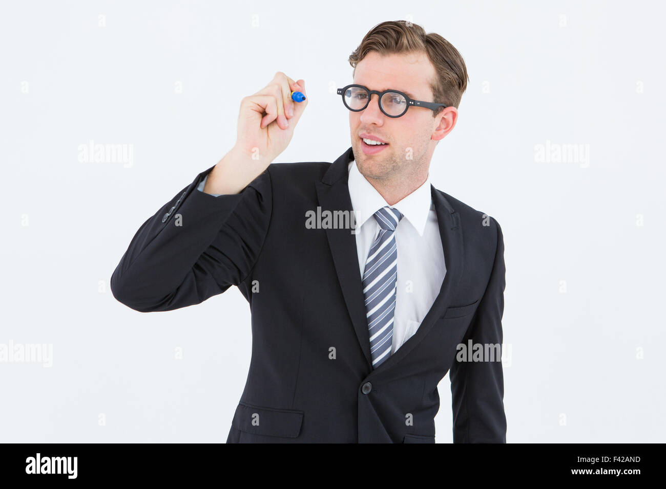 Geeky businessman writing with marker - Stock Image