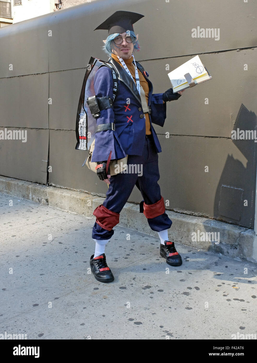 An  attendee of Comic Con in New York dresses as a Scholar, a character from Final Fantasy - Stock Image