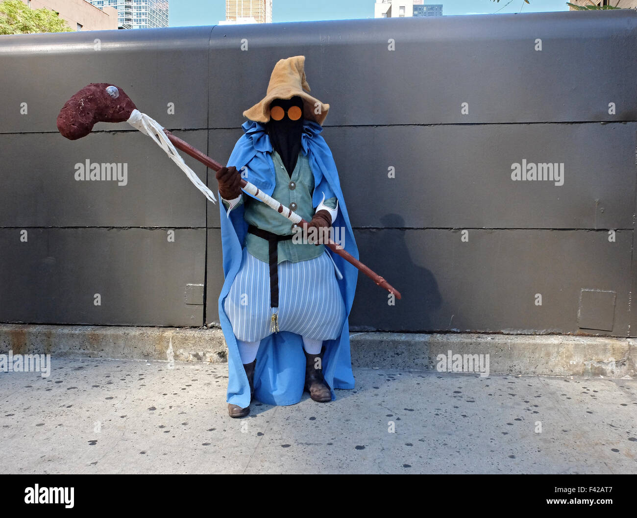 An  attendee of Comic Con in New York dresses as Vivi a Black Mage character from Final Fantasy - Stock Image