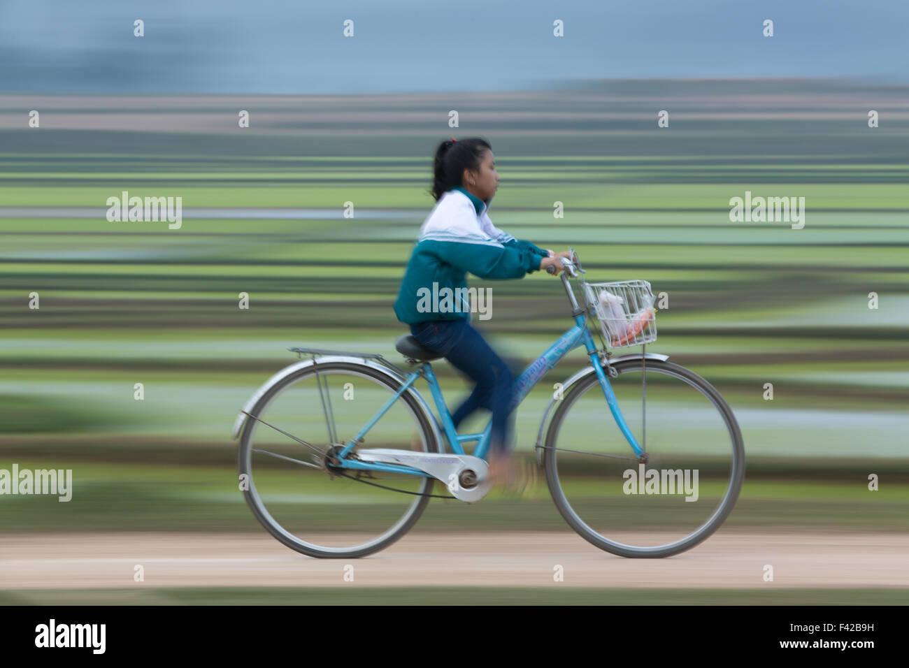 a school girl cycling nr Phong Nha, Quảng Bình Province, Vietnam - Stock Image