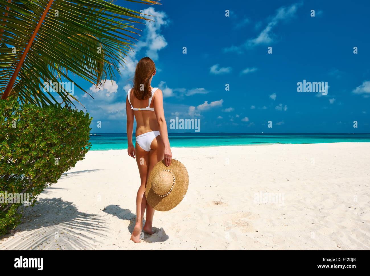 Woman in bikini on a beach at Maldives - Stock Image