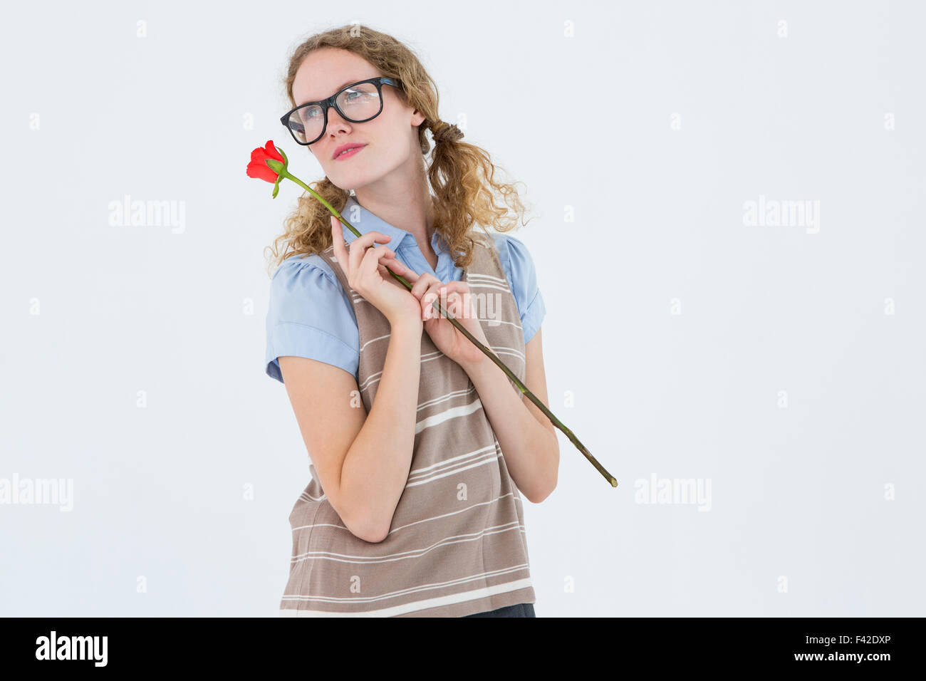 Geeky hipster woman holding rose - Stock Image