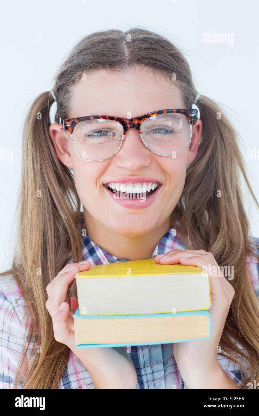 Geeky hipster smiling at camera - Stock Image