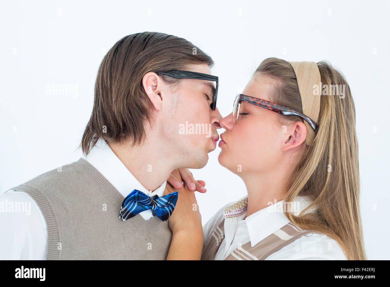 Geeky hipster couple kissing - Stock Image