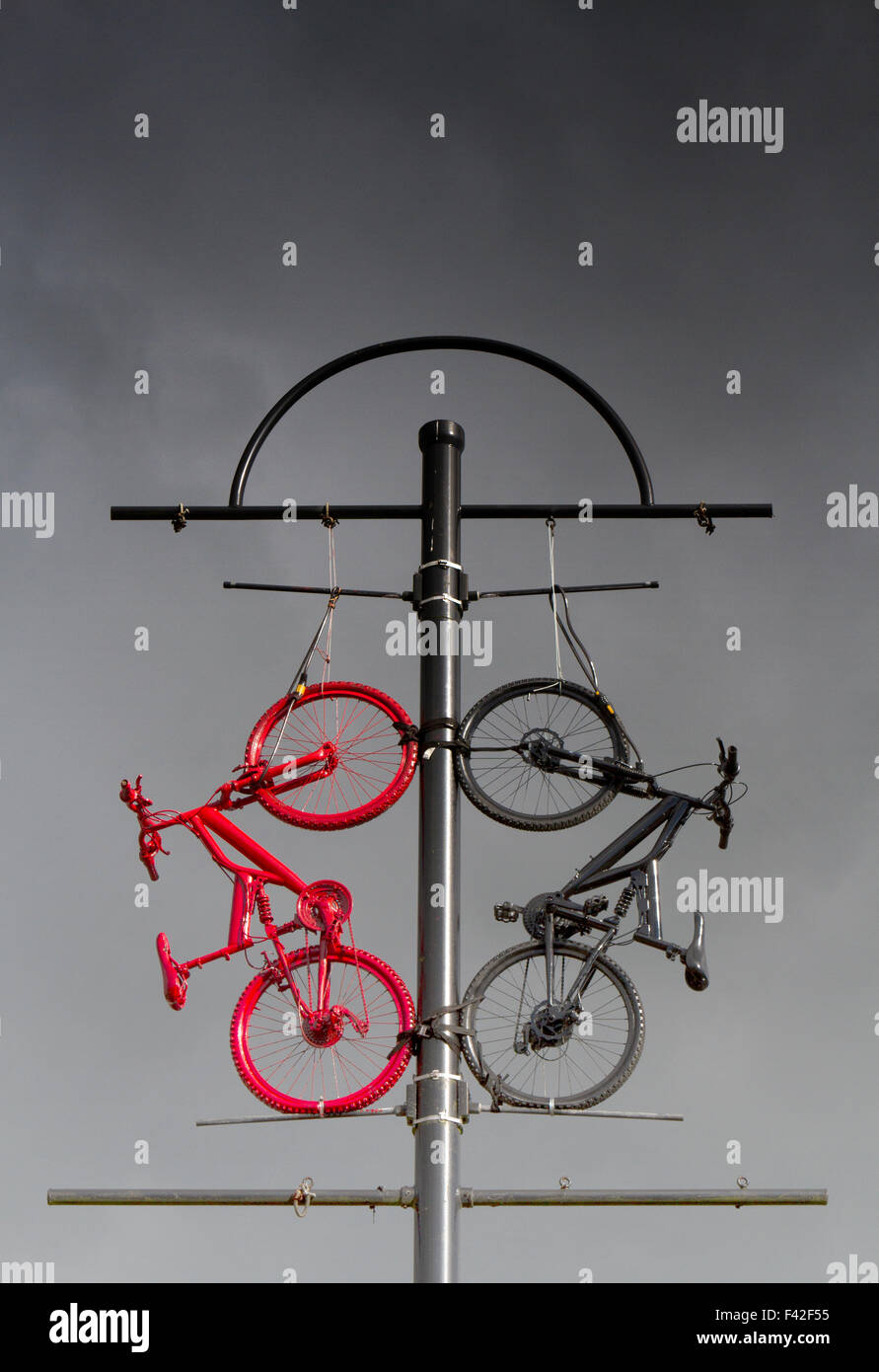 Two bikes, red & black used as Street Furniture, art, sculpture, bike, architecture, city, bicycle travel in Colne Stock Photo