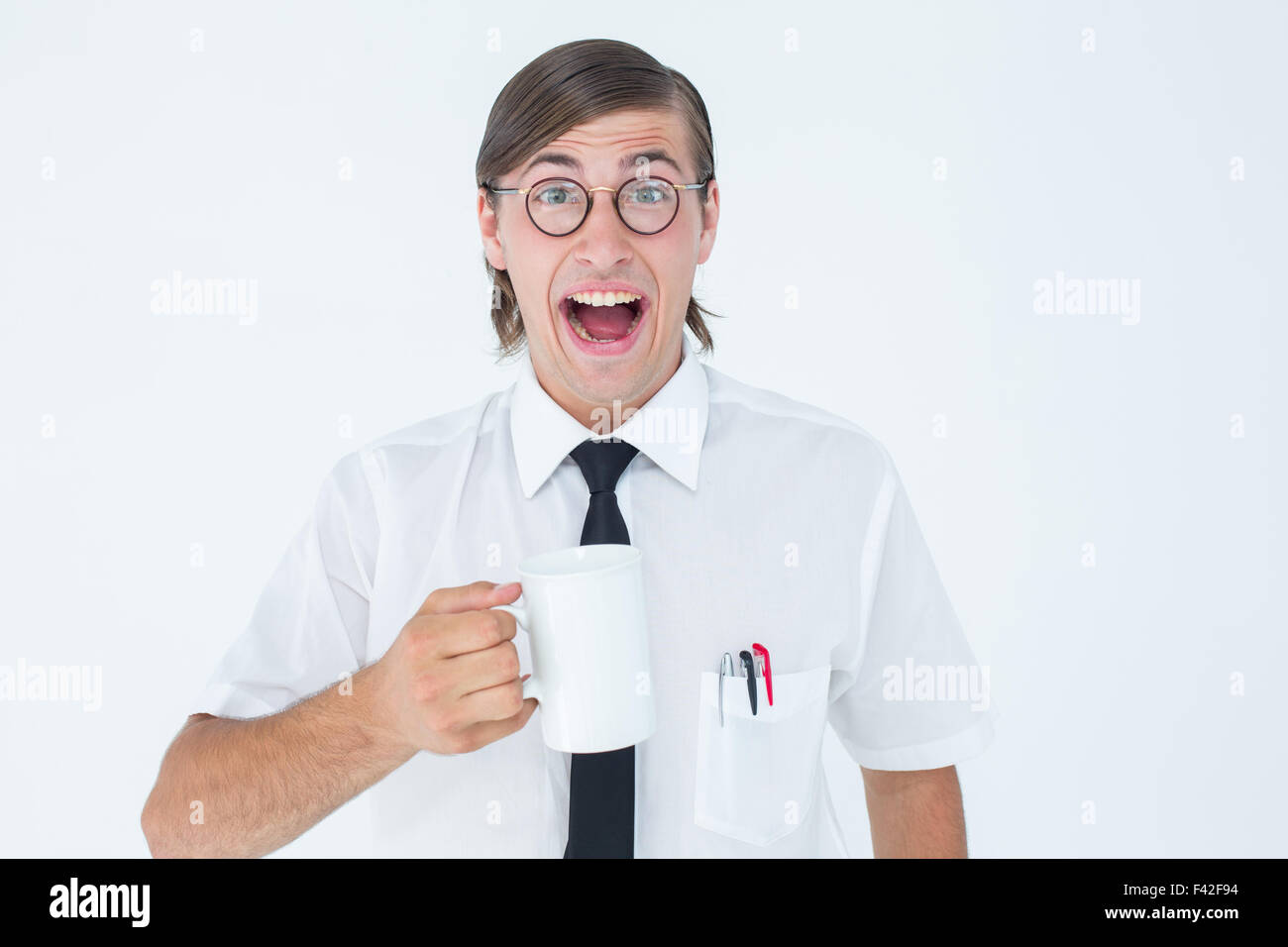 Geeky businessman holding a mug - Stock Image