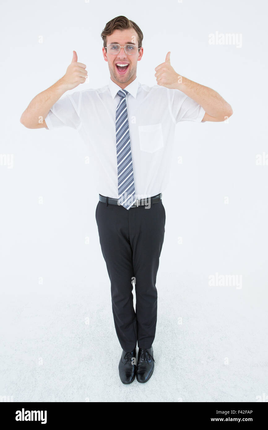 Happy geeky businessman with thumbs up - Stock Image