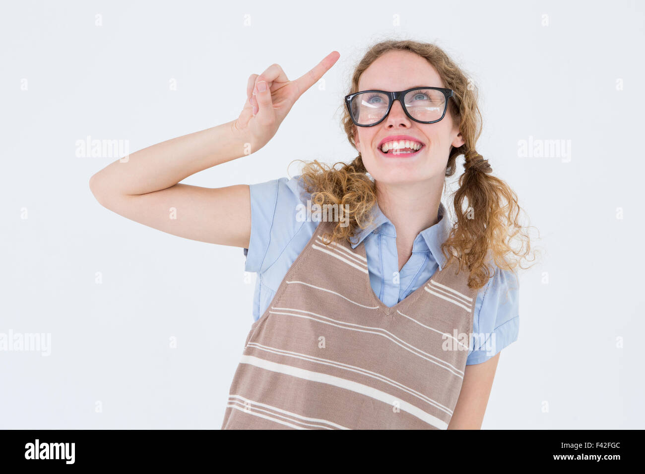 Geeky hipster woman pointing up - Stock Image