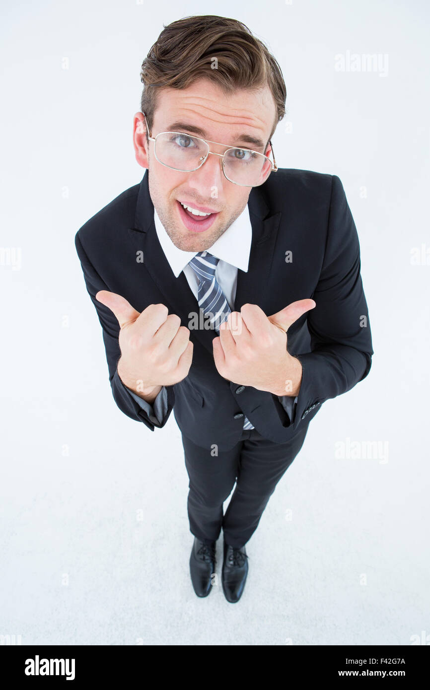 Geeky businessman with thumbs up - Stock Image