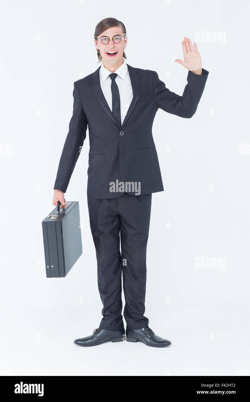 Geeky businessman waving at camera - Stock Image
