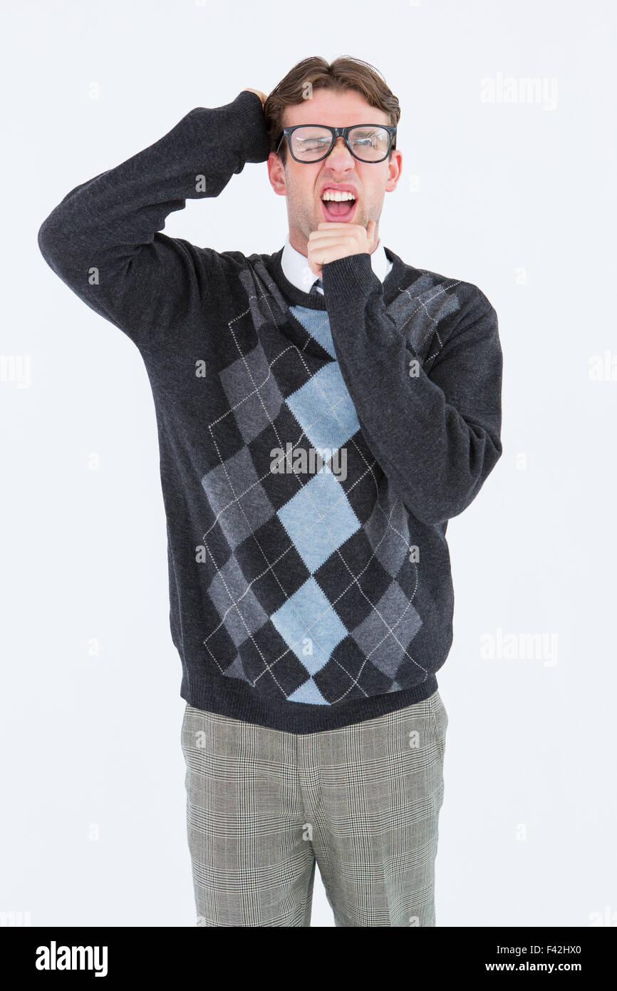Geeky hipster frowning at camera - Stock Image