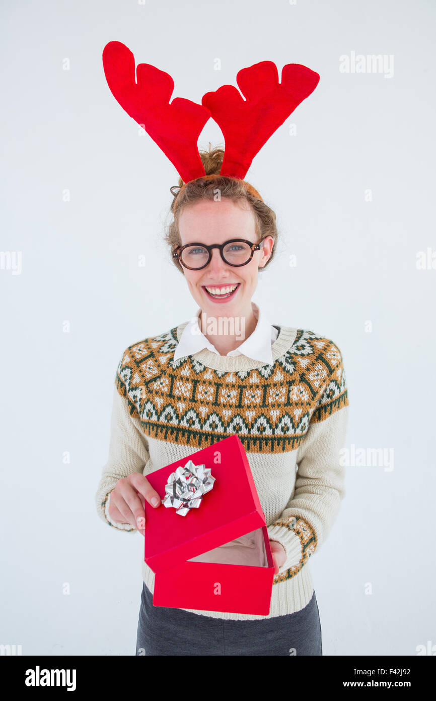 Happy geeky hipster opening present - Stock Image