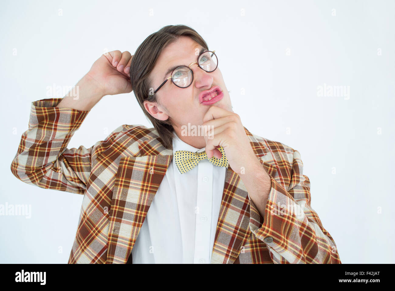 Geeky hipster scratching his head - Stock Image