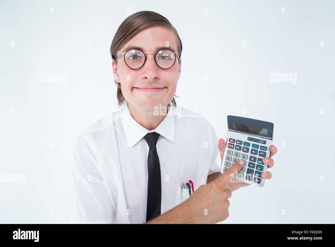 Geeky smiling businessman showing calculator - Stock Image