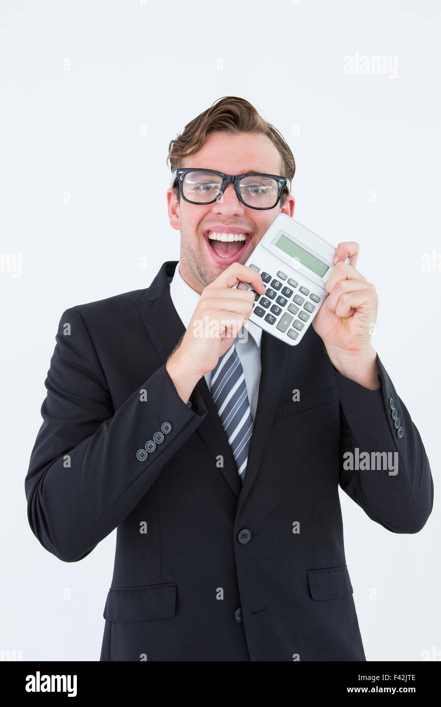 Geeky businessman pointing to calculator - Stock Image