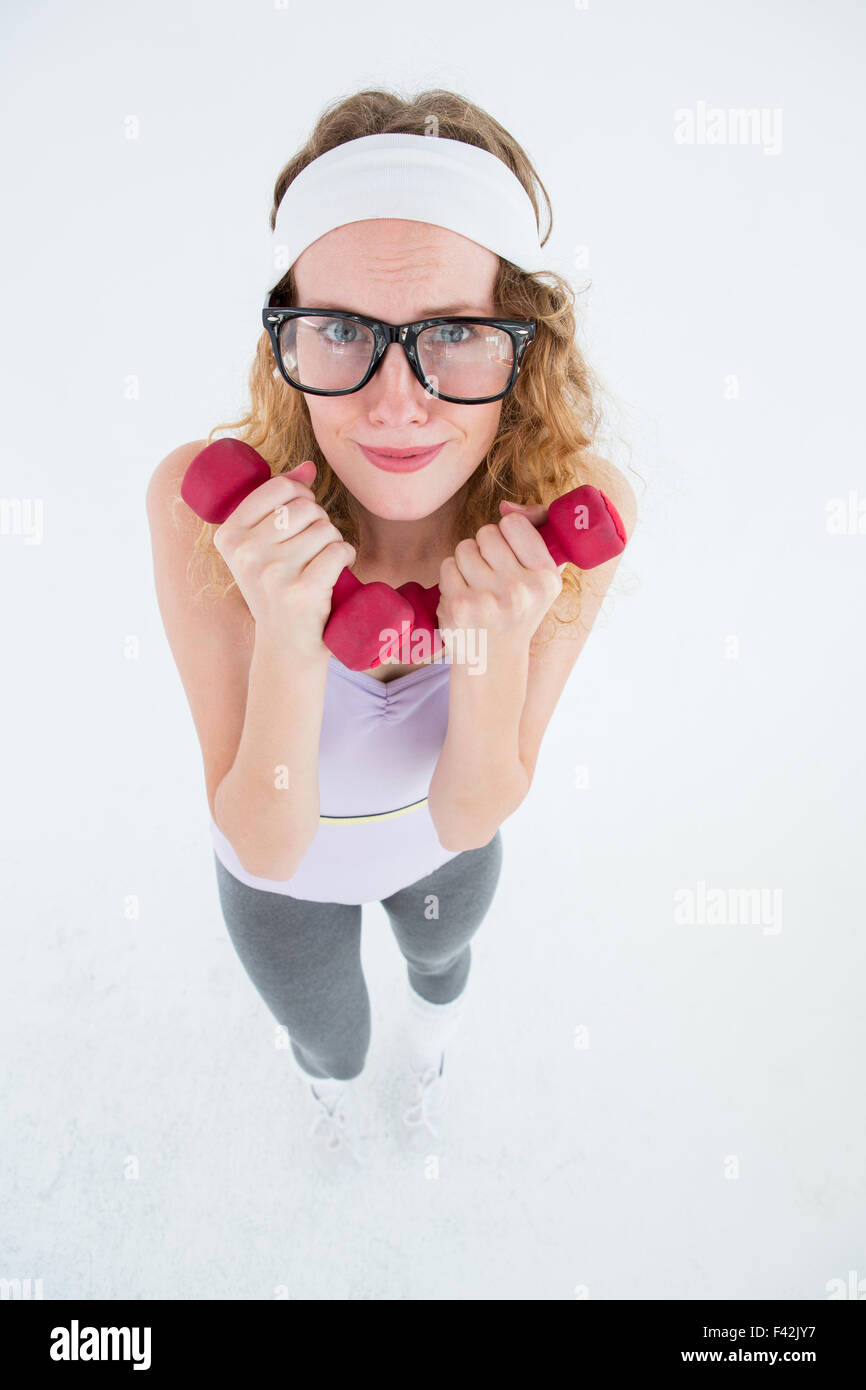 Geeky hipster lifting dumbbells - Stock Image