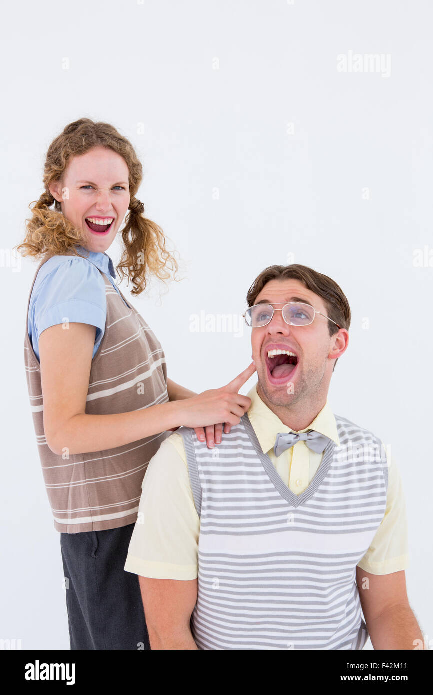 Excited geeky hipster couple - Stock Image