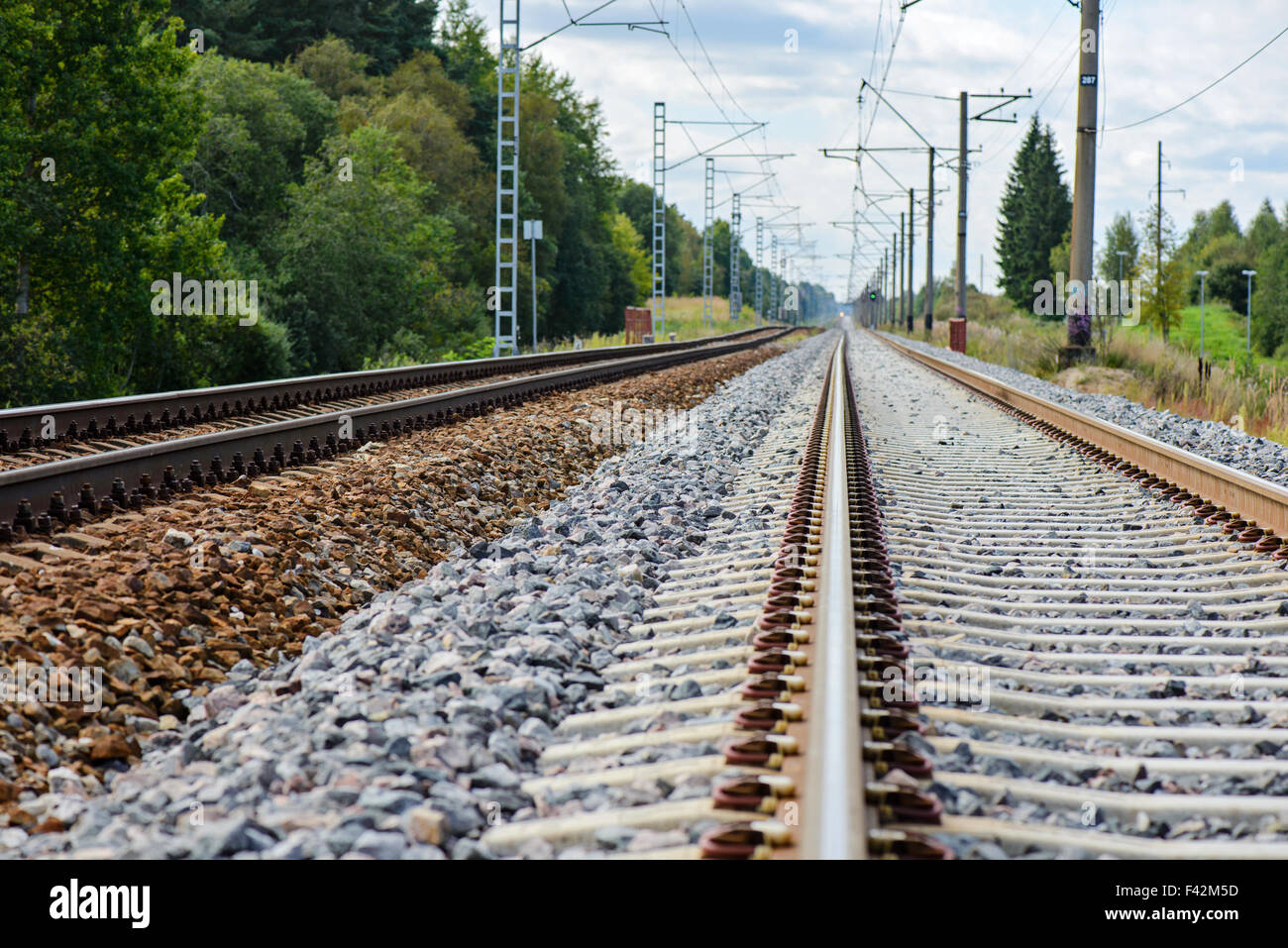 Railroad track vanishing into the distance - Stock Image