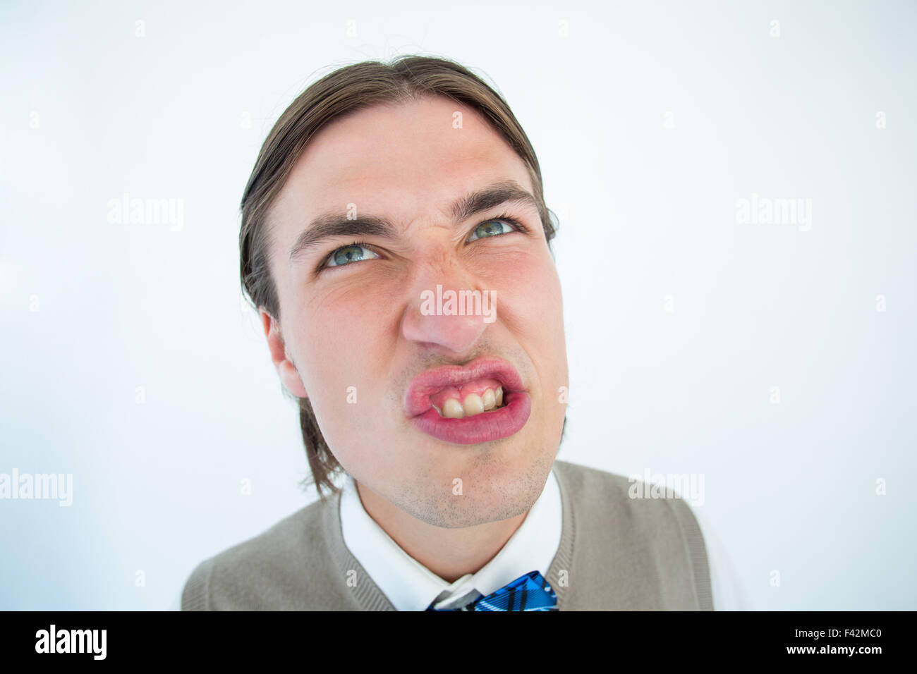 Geeky hipster grimacing - Stock Image