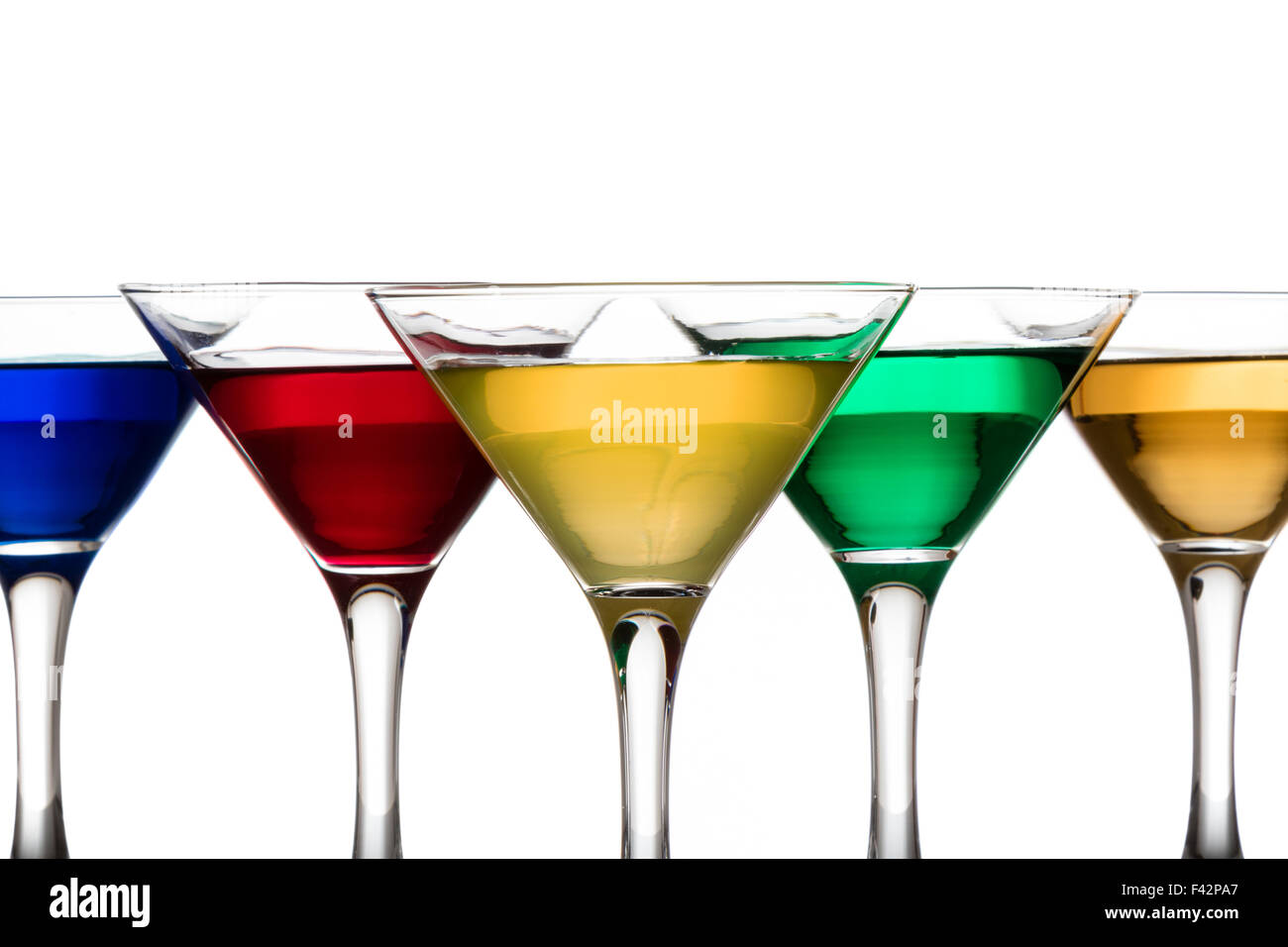 color cocktails in martini glasses - Stock Image